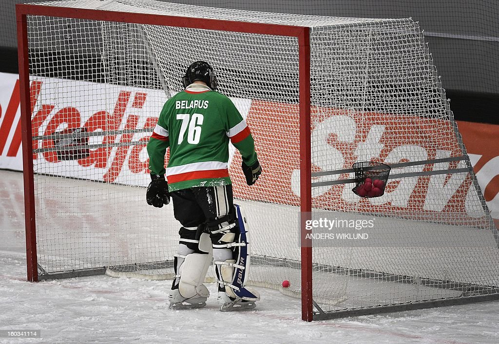 Belarus goalkeeper Dmitry Sergeev picks out the ball from the goal during the Bandy World Championship match between Sweden and Belarus in Vanersborg, Sweden, on January 29, 2013.