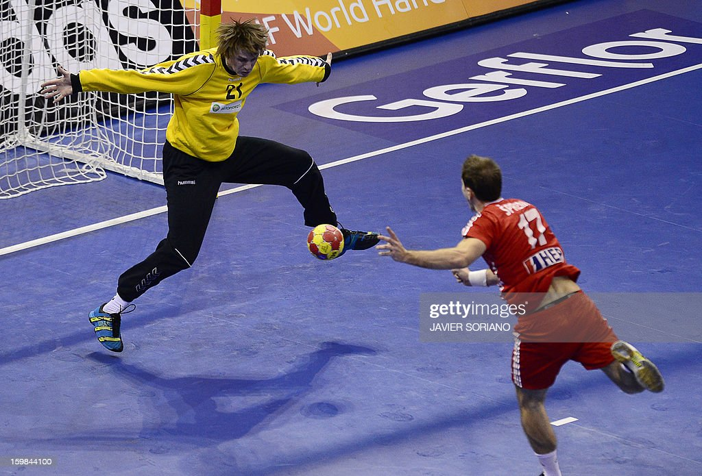 Belarus' goalkeeper Kazimir Kotlinski (L) tries to stop a shot by Croatia's left wing Lovo Sprem during the 23rd Men's Handball World Championships round of 16 match Croatia vs Belarus at the Pabellon Principe Felipe in Zaragoza on January 21, 2013. AFP PHOTO/ JAVIER SORIANO