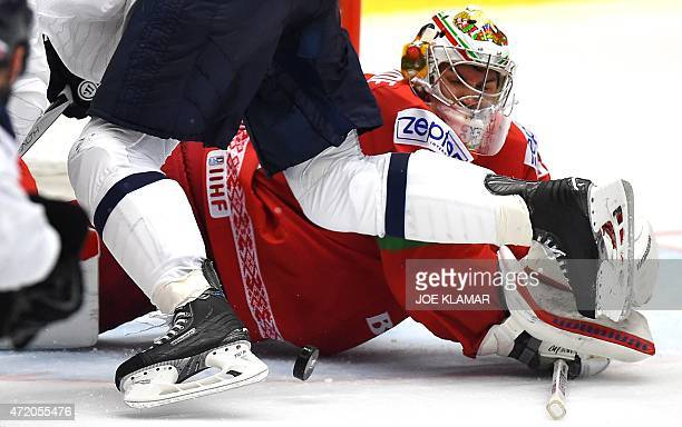 Belarus' goalkeeper Kevin Lalande tries to make a save during the group B preliminary round ice hockey match Belarus vs Slovakia of the IIHF...