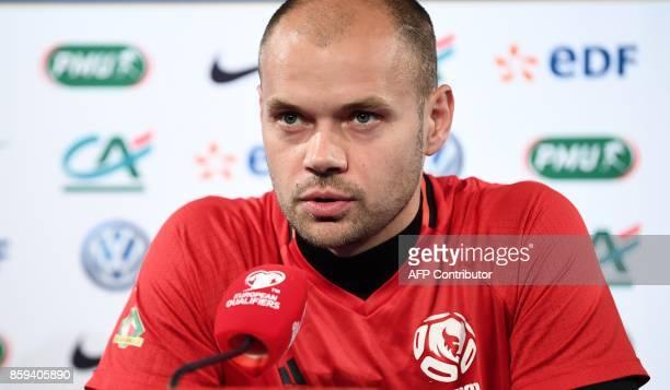 Belarus' goalkeeper Sergei Chernik speaks during a press conference at the Stade de France stadium in SaintDenis north of Paris on October 2017 on...