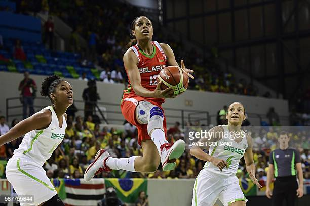 TOPSHOT Belarus' guard Lindsey Harding jumps for the basket by Brazil's point guard Adriana Moises during a Women's round Group A basketball match...