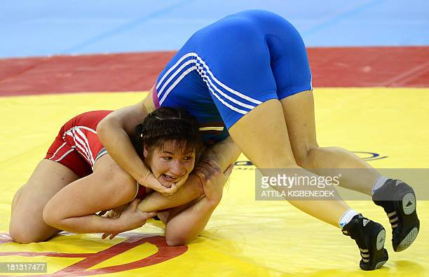 Belarus' Halina Leuchanka and Latvia's Laura Skujina fight during the women's free style 67 kg category during the qualification round of the FILA...