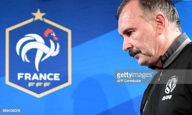 Belarus' head coach Igor Kriushenko arrives for a press conference at the Stade de France stadium in SaintDenis north of Paris on October 2017 on the...