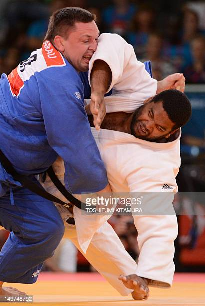 Belarus' Ihar Makarau competes with Cuba's Oscar Brayson during their men's 100kg judo contest repechage match of the London 2012 Olympic Games on...