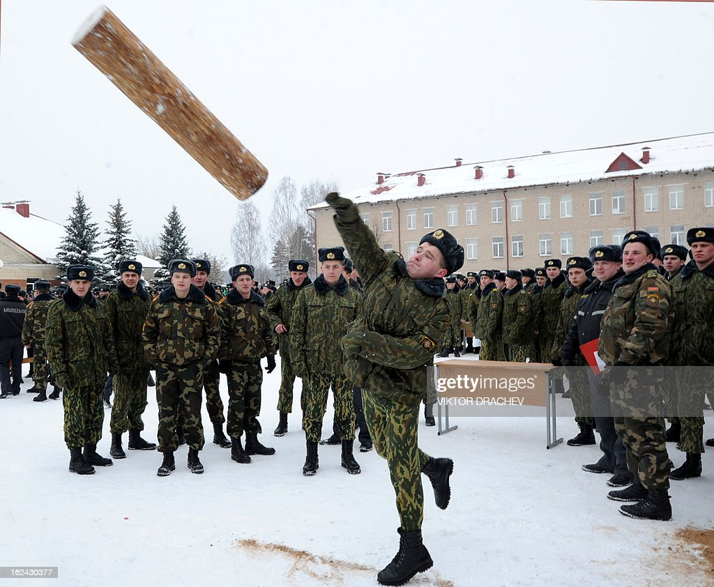 Belarus Interior Ministry serviceman throws a beam as he takes part in a competition to mark the Defenders of Fatherland Day at their training center near the village of Okolitsa some 30 km outside Minsk, on February 23, 2013. Belarus alongside with some countries of former USSR markes the Defenders of Fatherland Day on February 23.