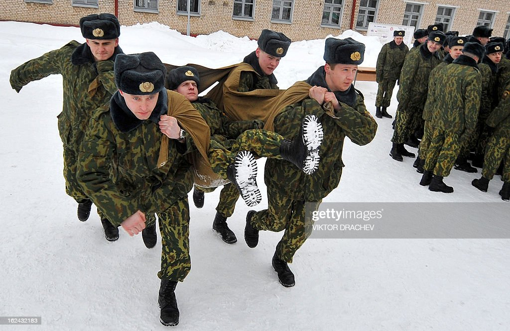 Belarus Interior Ministry servicemen carry each other during a competition to mark the Defenders of Fatherland Day at their training center near the village of Okolitsa some 30 km outside Minsk, on February 23, 2013. Belarus alongside with some countries of former USSR markes the Defenders of Fatherland Day on February 23.