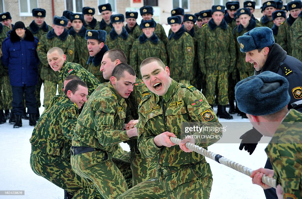 Belarus Interior Ministry servicemen participate in tug of war as they take part in a competition to mark the Defenders of Fatherland Day at their training center near the village of Okolitsa some 30 km outside Minsk, on February 23, 2013. Belarus alongside with some countries of former USSR markes the Defenders of Fatherland Day on February 23.