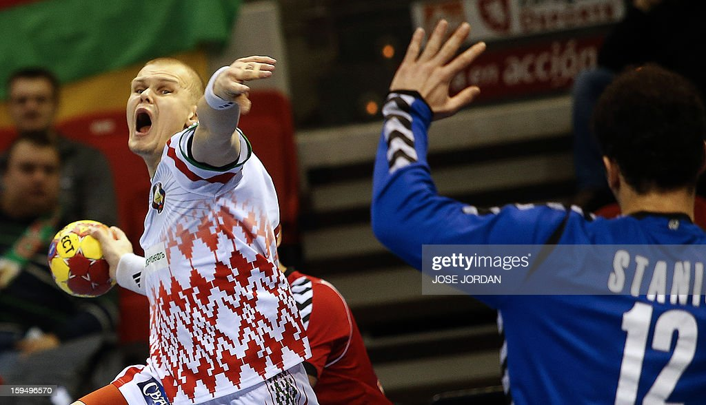 Belarus' left wing Ivan Brouka (L) vies with Serbia's goalkeeper Darko Stanic during the 23rd Men's Handball World Championships preliminary round Group C match Belarus vs Serbia at the Pabellon Principe Felipe in Zaragoza on January 14, 2013.