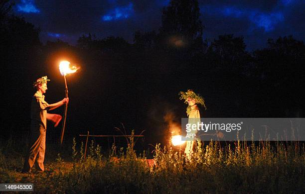 Belarus men and women celebrate Ivana Kupala night an ancient heathen holiday in the countryside near the village in the Kulneva some 280 km north...