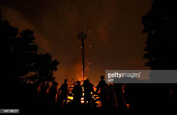 Belarus men and women dance around a bonfire in the countryside of the Gomel region some 350 km southeast the capital Minsk early on June 23 to mark...