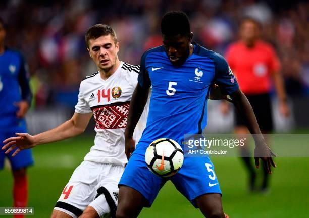 Belarus' midfielder Aleksandr Karnitski vies for the ball with France's defender Samuel Umtiti during the FIFA World Cup 2018 qualification football...