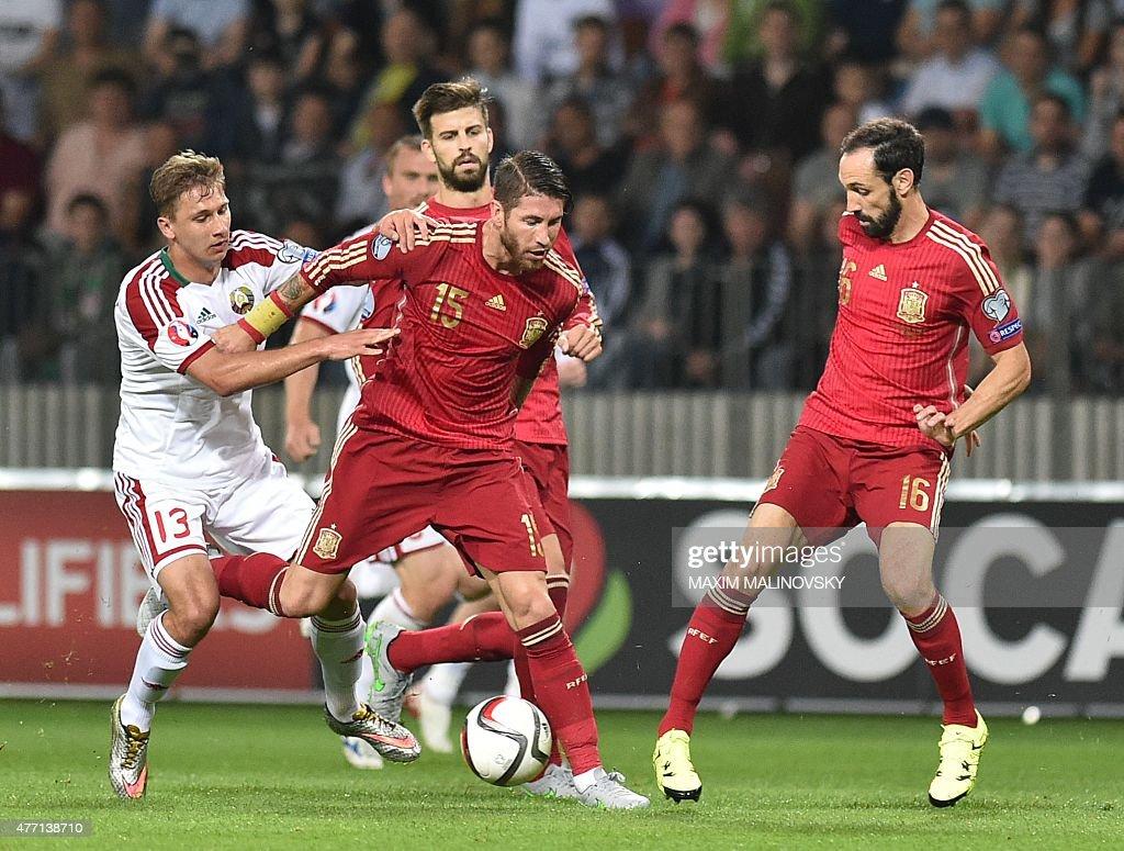 Belarus' midfielder Maksim Volodko Spain's defender Sergio Ramos Spain's defender Juanfran and Spain's defender Gerard Pique vie for the ball during...
