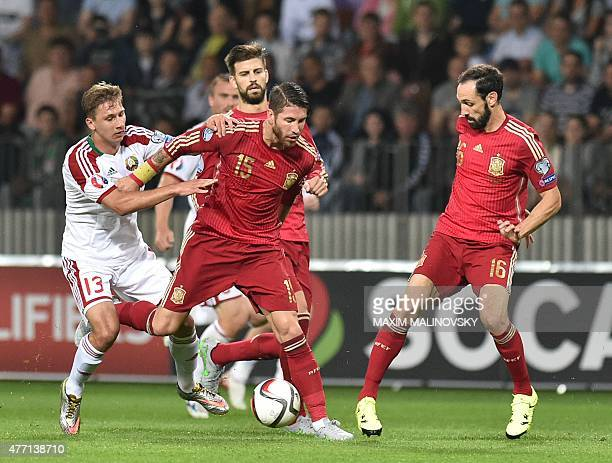 Belarus' midfielder Maksim Volodko Spain's defender Sergio Ramos Spain's defender Juanfran and Spain's defender Gerard Pique vie for the ball during...