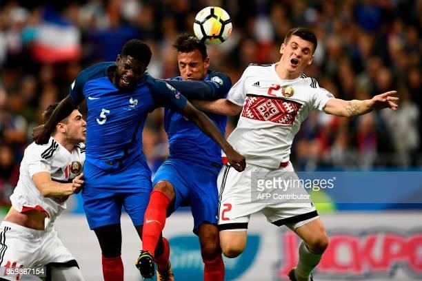 Belarus' midfielder Stanislav Dragun France's midfielder Corentin Tolisso and France's defender Samuel Umtiti vie for the ball during the FIFA World...
