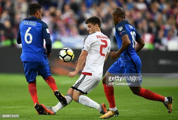 Belarus' midfielder Stanislav Dragun vies for the ball with France's midfielder Corentin Tolisso and France's defender Djibril Sidibe during the FIFA...