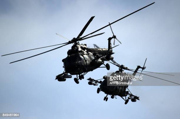 Belarus' military helicopters fly during the joint RussianBelarusian military exercises Zapad2017 at a training ground near the village of Volka some...