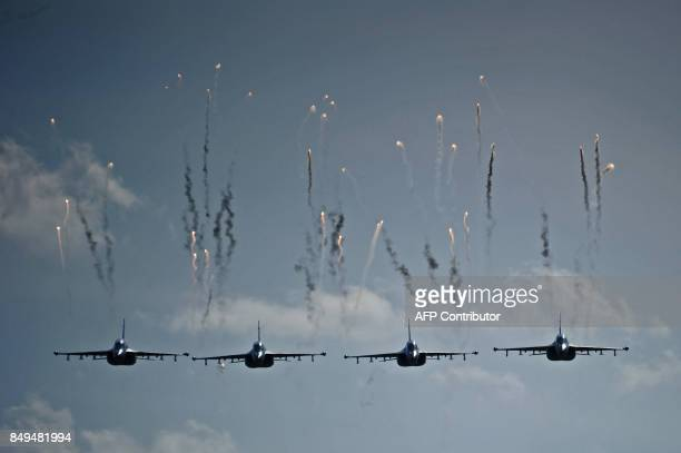 TOPSHOT Belarus' military jets fly during the joint RussianBelarusian military exercises Zapad2017 at a training ground near the village of Volka...
