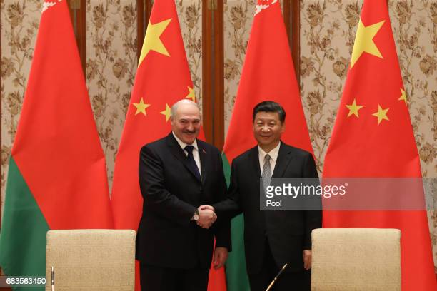 Belarus President Alexander Lukashenko and Chinese President Xi Jinping shakes hands during a signing ceremony after a bilateral meeting at Diaoyutai...