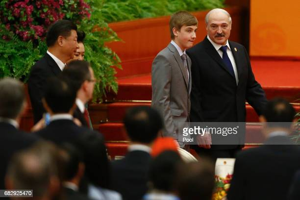 Belarus President Alexander Lukashenko and his son Nikolai arrive for the welcoming banquet for the Belt and Road Forum at the Great Hall of the...