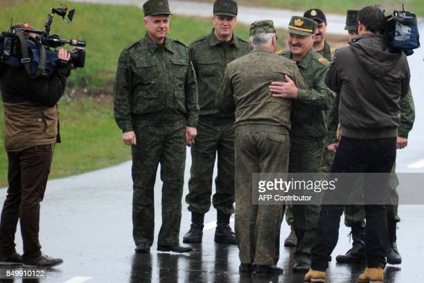 Belarus' President Alexander Lukashenko greets military officials as he arrives to inspect the joint RussianBelarusian military exercises Zapad2017...