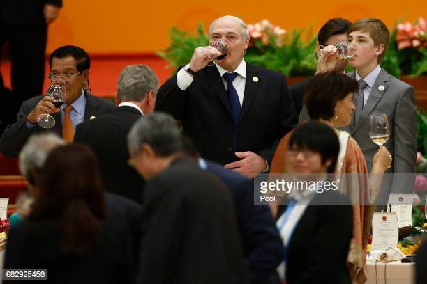 Belarus President Alexander Lukashenko his son Nikolai and Cambodia's Prime Misnietr Hun Sen make a toast during the welcoming banquet for the Belt...
