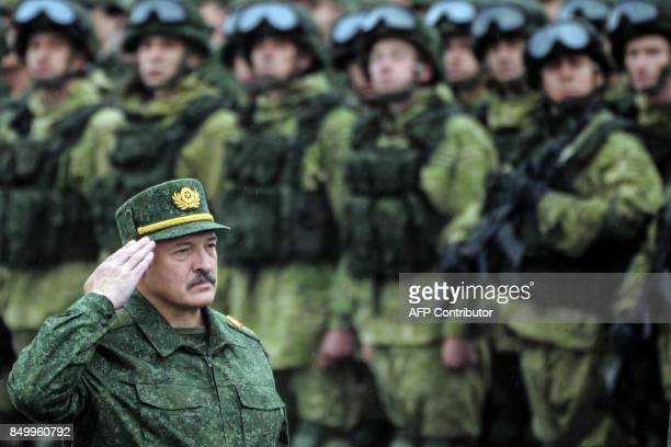 TOPSHOT Belarus' President Alexander Lukashenko salutes while standing in front of servicemen during the joint RussianBelarusian military exercises...
