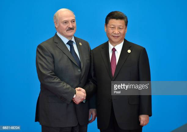Belarus' President Alexander Lukashenko shakes hands with Chinese President Xi Jinping during the welcome ceremony for the Belt and Road Forum at the...