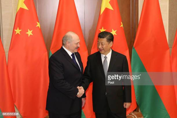 Belarus President Alexander Lukashenko shakes hands with Chinese President Xi Jinping ahead a bilateral meeting at Diaoyutai State Guesthouse on May...