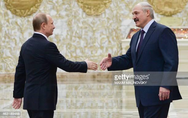 Belarus President Alexander Lukashenko welcomes his Russian counterpart Vladimir Putin at the presidential residence in Minsk on February 11 2015...