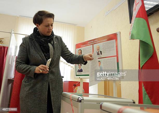 Belarus' Presidential candiadate Tatiana Karatkevich casts her ballot during presidential elections at a polling station in Minsk on October 11 2015...
