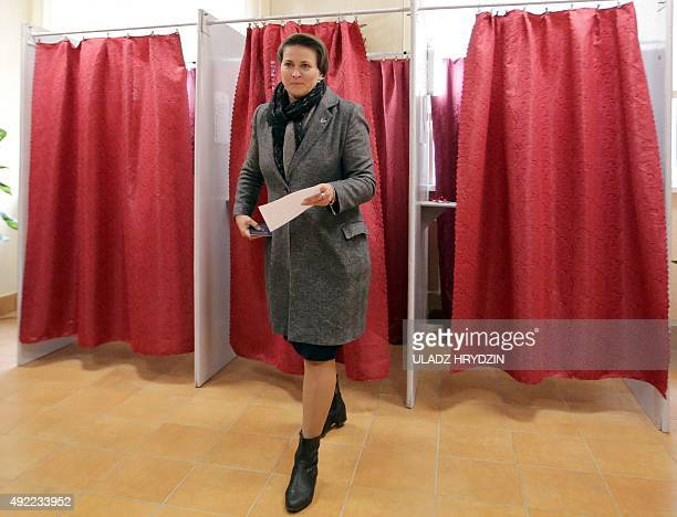 Belarus' Presidential candiadate Tatiana Karatkevich leaves a ballot box for voting during presidential elections at a polling station in Minsk on...