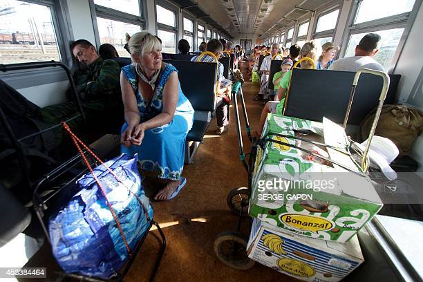A Belarus seller travels by train from the Belarus city of Orsha to the Russian city of Smolensk with boxes of vegetables milk and sausages on August...