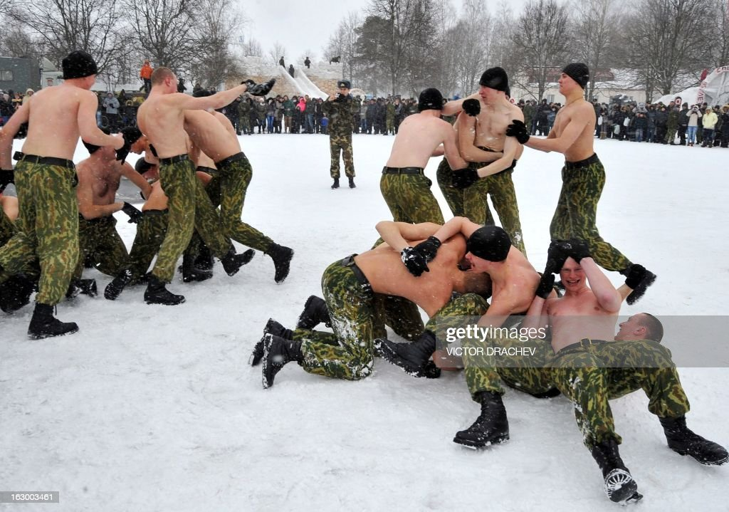 Belarus soldiers from an Interior Ministry special unit fight together during a military show marking Maslenitsa holiday on the outskirts of Minsk on March 3, 2013. Maslenitsa is an medieval pagan festival that celebrates the end of winter and the start of spring.