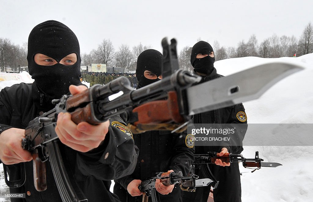 Belarus soldiers from an Interior Ministry special unit participate in a military show marking Maslenitsa holiday on the outskirts of Minsk on March 3, 2013. Maslenitsa is an medieval pagan festival that celebrates the end of winter and the start of spring. AFP PHOTO / VICTOR DRACHEV
