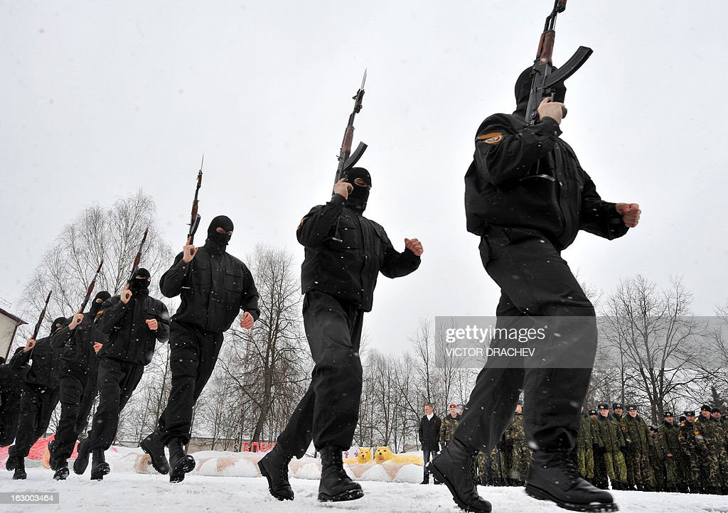 Belarus soldiers from an Interior Ministry special unit participate in a military show marking Maslenitsa holiday on the outskirts of Minsk on March 3, 2013. Maslenitsa is an medieval pagan festival that celebrates the end of winter and the satrt of spring.