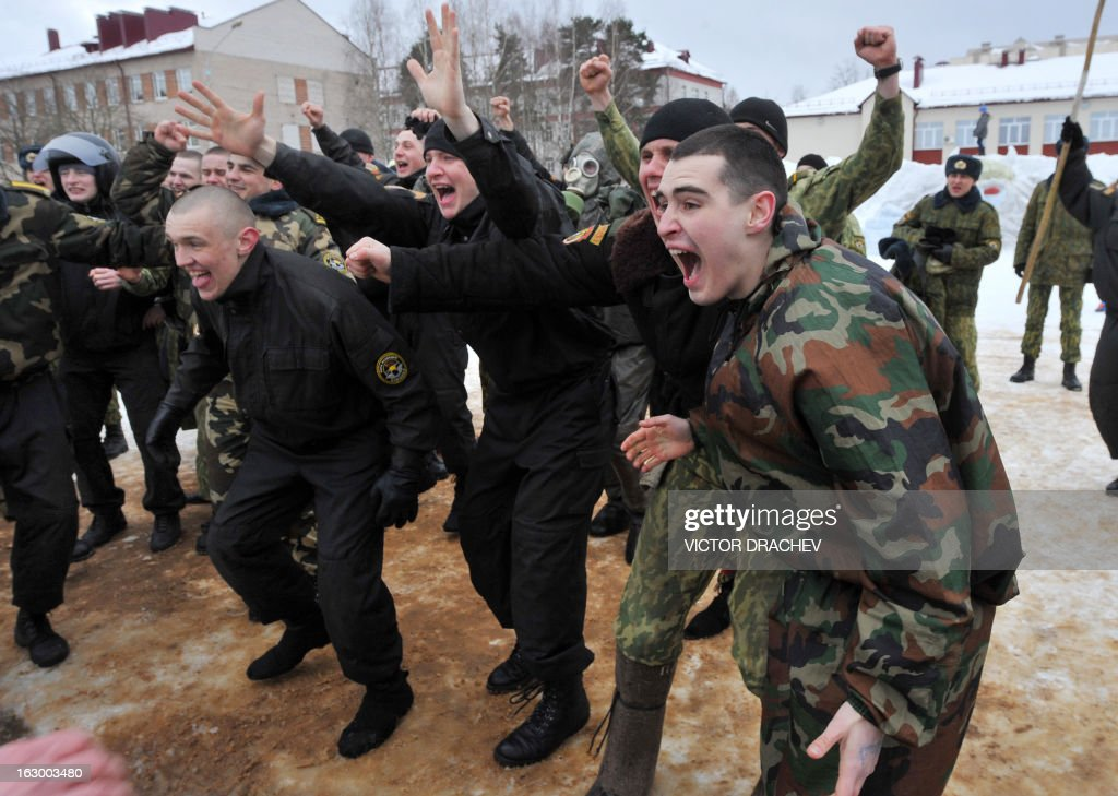 Belarus soldiers from an Interior Ministry special unit support their team during a military show marking Maslenitsa holiday on the outskirts of Minsk on March 3, 2013. Maslenitsa is an medieval pagan festival that celebrates the end of winter and the start of spring. AFP PHOTO / VICTOR DRACHEV