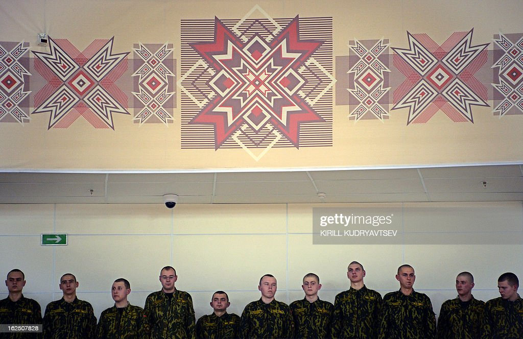 Belarus soldiers watch the UCI Track Cycling World Championships Men's 50 km Madison in Minsk on February 24, 2013.