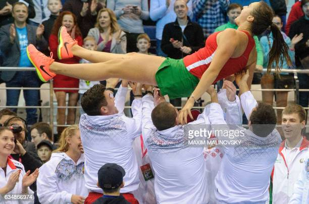 Belarus' team members carry Aryna Sabalenka as they celebrate her victory after the Fed Cup World Group first round tennis match between Belarus and...