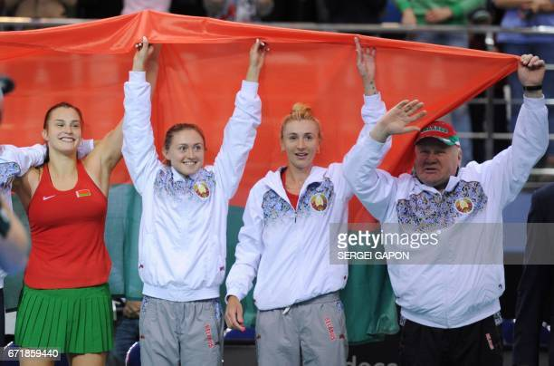 Belarus' team members celebrate after winning the semifinals of the Fed Cup tennis competition between Belarus and Switzerland in Minsk on April 23...