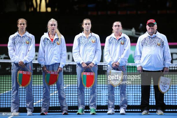 Belarus' tennis players Vera Lapko Olga Govortsova Aryna Sabalenka Aliaksandra Sasnovich and team captain Eduard Dubrou pose before the semifinals of...