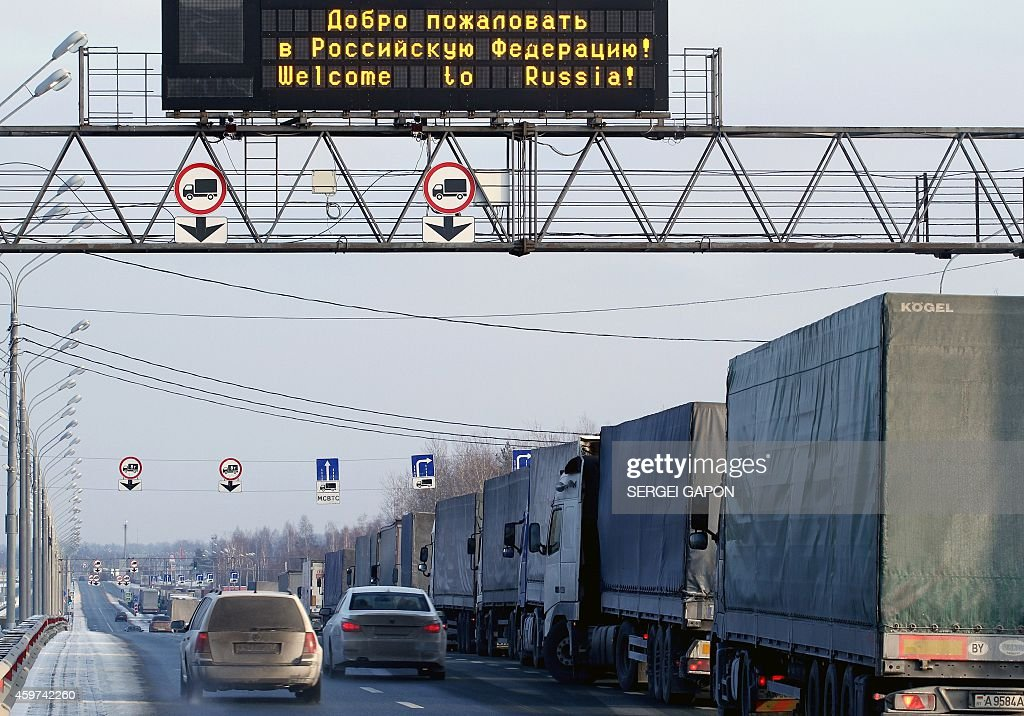 Belarus trucks wait for the sanitary control clearance at a Russian border checkpoint outside Smolensk at the RussianBelarus border on November 30...