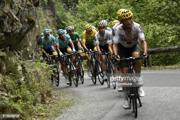 Belarus' Vasil Kiryienka Spain's Mikel Landa Great Britain's Christopher Froome wearing the overall leader's yellow jersey and Italy's Fabio Aru ride...
