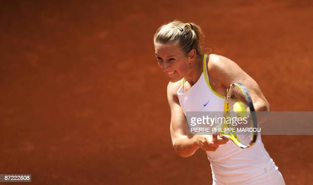 Belarus' Victoria Azarenka returns a ball to Hungarian Agnes Szavay during their match of the ATP Madrid Masters claycourt tournament on May 14 2009...