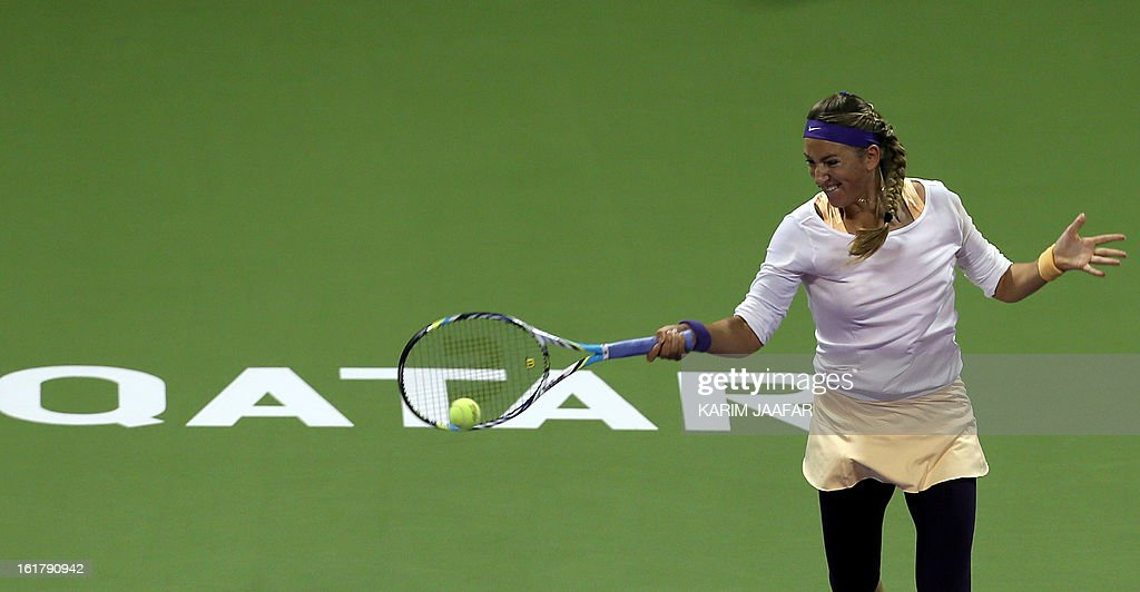 Belarus Victoria Azarenka returns the ball to Agnieszka Radwanska of Poland during their WTA Qatar Open semi-final tennis match on February 16, 2013 in the Qatari capital, Doha.