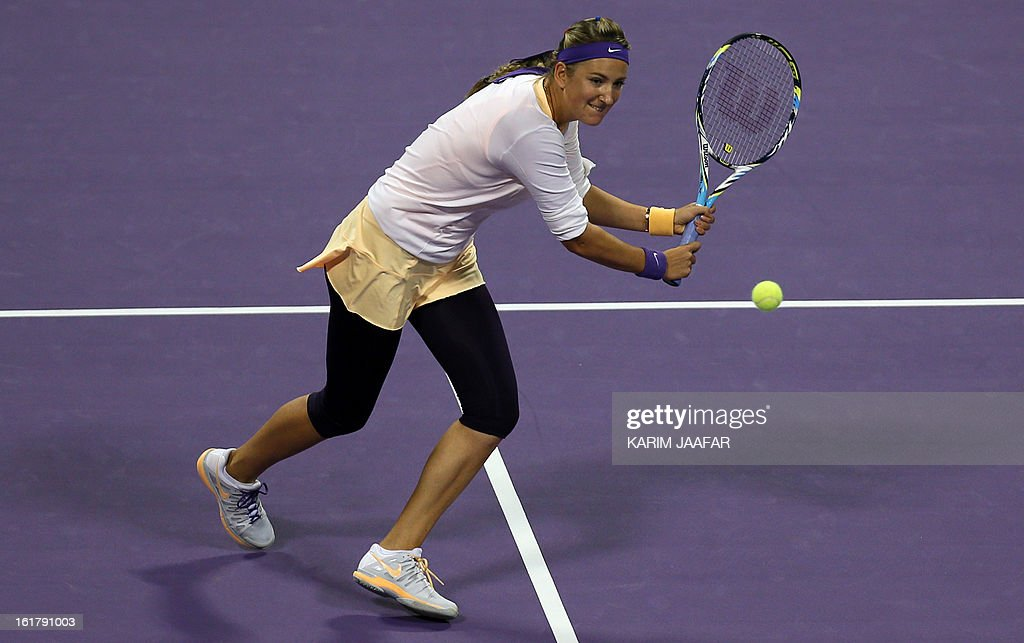 Belarus Victoria Azarenka returns the ball to Agnieszka Radwanska of Poland during their WTA Qatar Open semi-final tennis match on February 16, 2013 in the Qatari capital, Doha. AFP PHOTO / AL-WATAN DOHA / KARIM JAAFAR == QATAR OUT ==