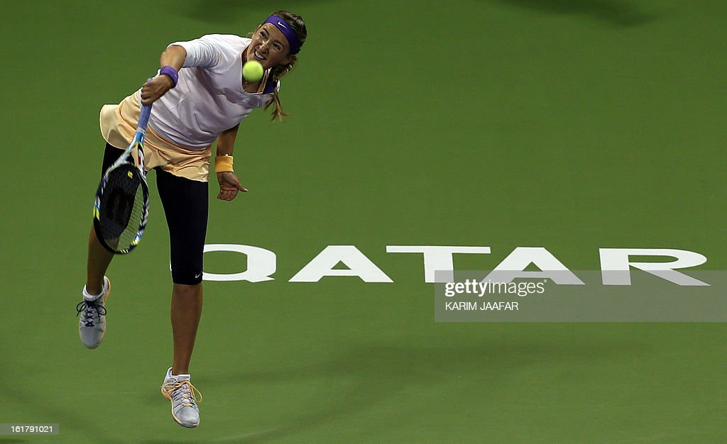 Belarus Victoria Azarenka returns the ball to Agnieszka Radwanska of Poland during their WTA Qatar Open semi-final tennis match on February 16, 2013 in the Qatari capital, Doha. AFP PHOTO / AL-WATAN DOHA / KARIM JAAFAR == QATAR OUT ==