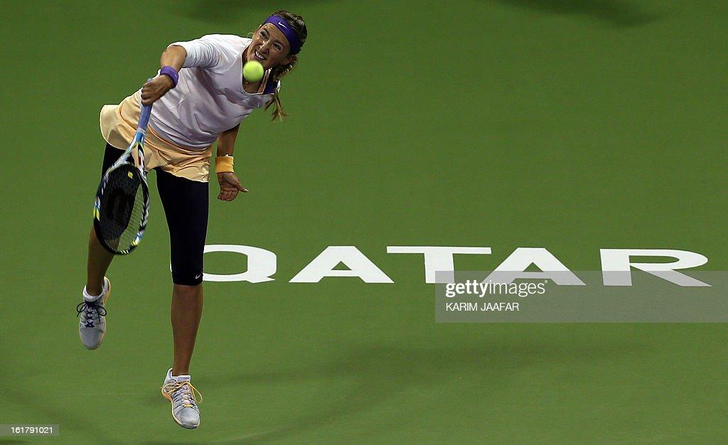 Belarus Victoria Azarenka returns the ball to Agnieszka Radwanska of Poland during their WTA Qatar Open semi-final tennis match on February 16, 2013 in the Qatari capital, Doha.