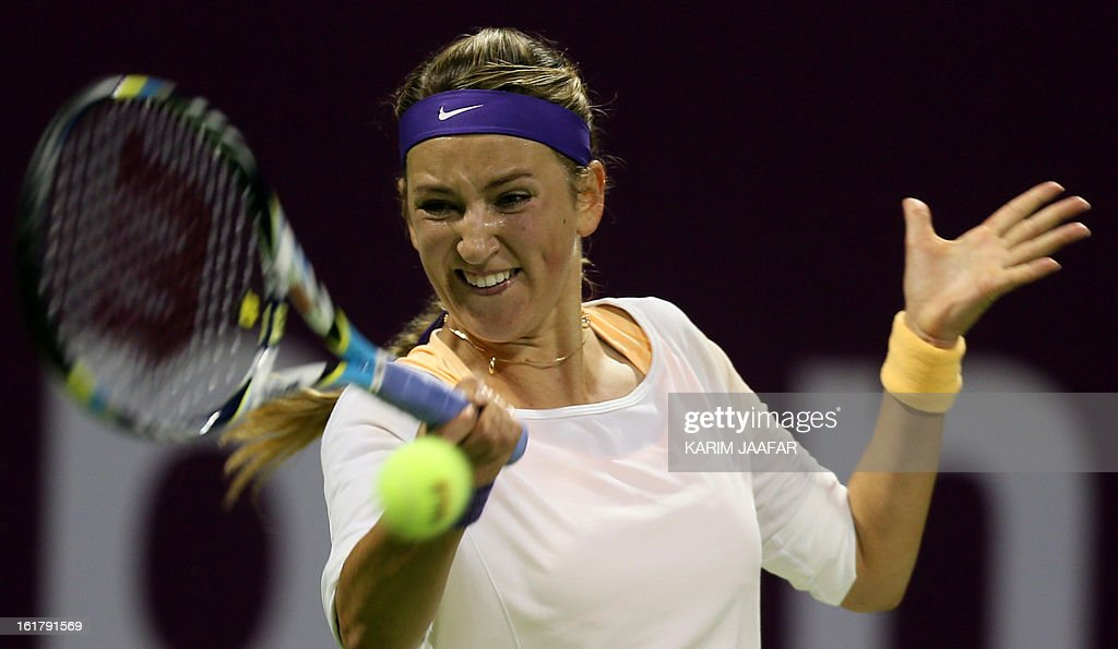 Belarus Victoria Azarenka returns the ball to Agnieszka Radwanska of Poland during their WTA Qatar Open semi-final tennis match on February 16, 2013 in the Qatari capital, Doha. Azarenka won 6-3, 6-3.