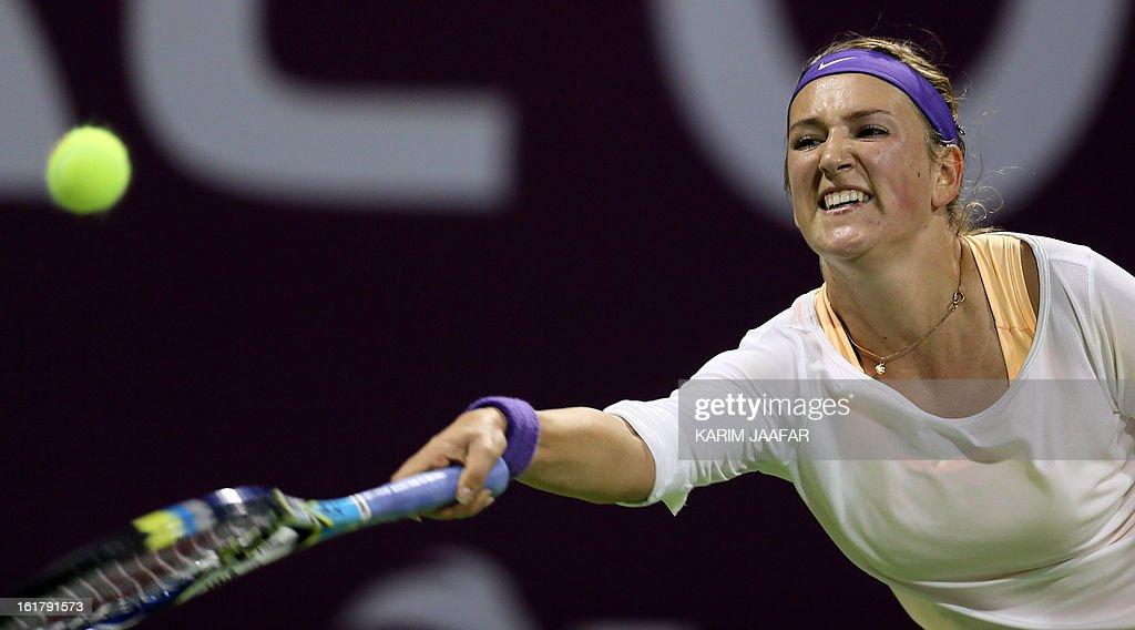 Belarus Victoria Azarenka returns the ball to Agnieszka Radwanska of Poland during their WTA Qatar Open semi-final tennis match on February 16, 2013 in the Qatari capital, Doha. Azarenka won 6-3, 6-3. AFP PHOTO / AL-WATAN DOHA / KARIM JAAFAR == QATAR OUT ==