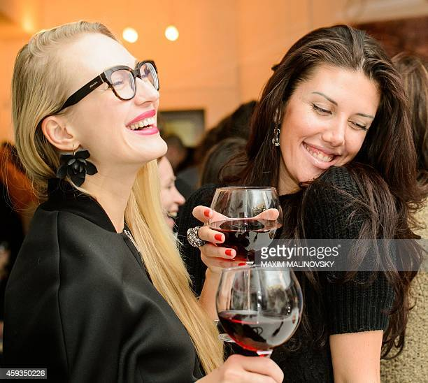 Belarus women drink the 2014 Beaujolais Nouveau wine during an event at the Ubar in Minsk on November 20 2014 AFP PHOTO / MAXIM MALINOVSKY